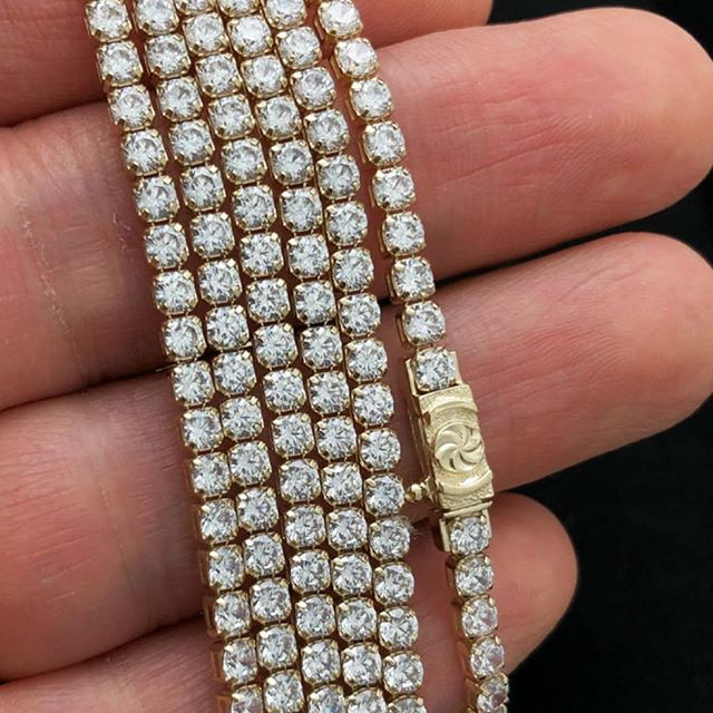 Yellow gold, baguette diamonds and high quality shine, yours today from HipHopBling.com