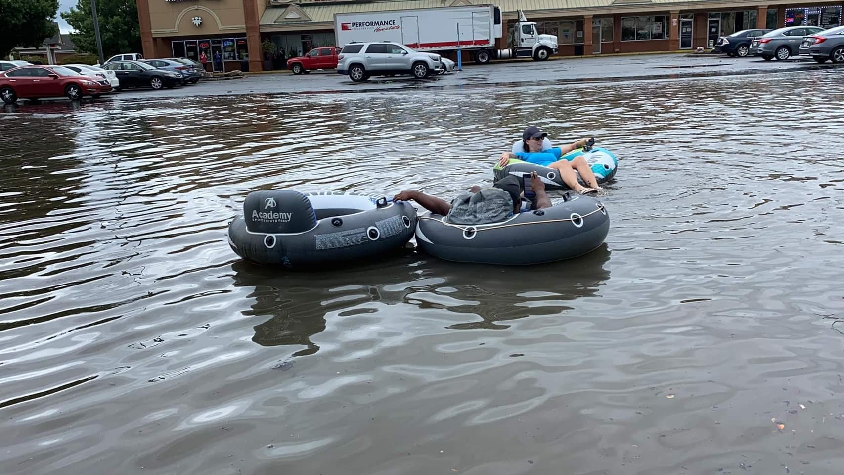 HAPPENING NOW: People are floating around in Academy Parking lot in Warner Robins.