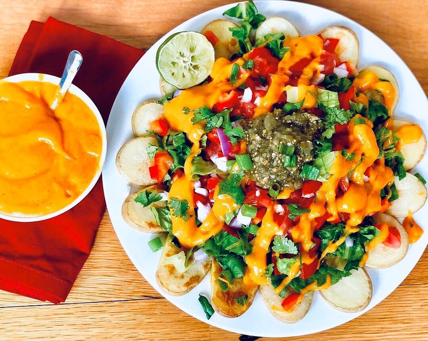 Potato nachos with the best ever vegan queso! Try this recipe - Elle Valentine